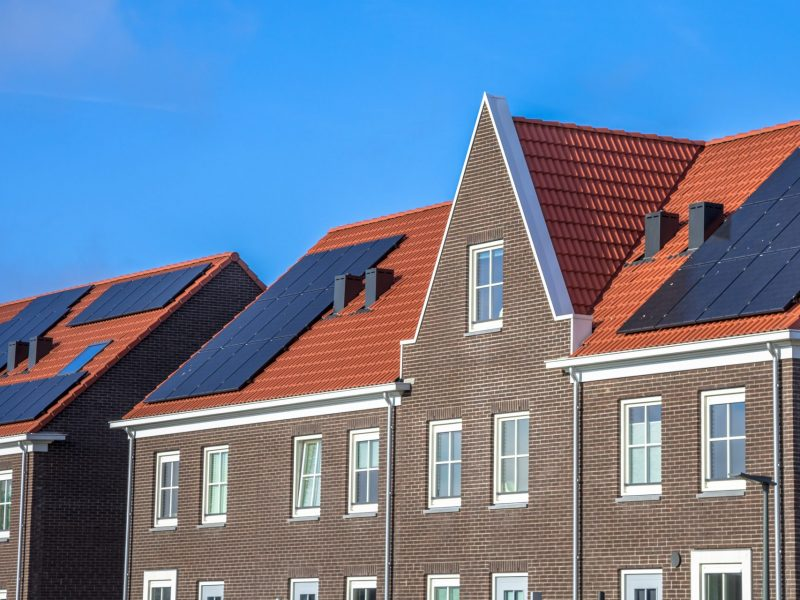 close-up-of-modern-row-houses-with-solar-panels-P72ZCRD